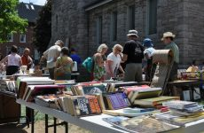 """Ottawa, Canada - May 29, 2010:  Thousands of people gather at the annual Glebe neighborhood garage sale which takes place for several blocks in the Glebe area of Ottawa."""