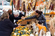 Ottawa, Canada - October 11, 2014: Shoppers at Byward Market in Ottawa during the day. Various fruit and vegetables can be seen.