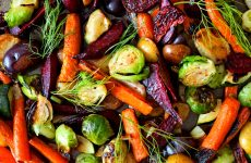 Full background of colorful roasted autumn vegetables, above view