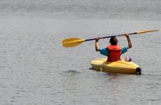 Young Girl in Yellow Kayak